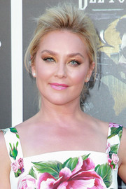 Elisabeth Rohm attended the premiere of 'Sicario: Day of the Soldado' wearing her hair in a pompadour ponytail.