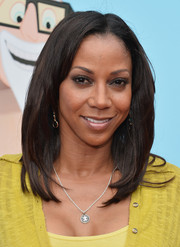 Holly Robinson Peete wore her hair straight with a center part when she attended the premiere of 'Cloudy with a Chance of Meatballs 2.'