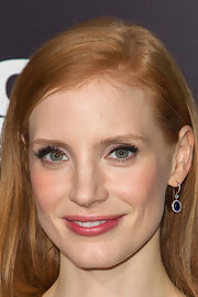 Jessica Chastain matched her sapphire and diamond Harry Winston earrings to her blue cocktail dress.