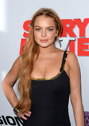 Lindsay Lohan showed off her strawberry locks with long and natural waves, which featured braided detailing at the crown.