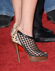 Lindsay Lohan rocked a pair of platform ankle booties that featured a checkered cage detailing.