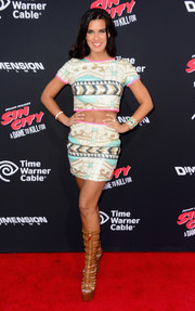 Natalie Burn completed her look with an attention-grabbing pair of gladiator heels.