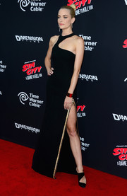 Jaime King looked like a modern-day goddess in a black Versace halter gown with an asymmetrical neckline and a revealing slit during the 'Sin City' premiere.
