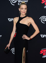 Jaime King complemented her sexy dress with a black Jimmy Choo Cloud clutch.