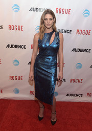 Ashley Greene looked festive in a shimmery blue cutout dress by Akris while attending the premiere of 'Rogue.'