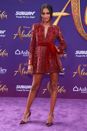 Jasmine Tookes looked elegant in a beaded red tunic dress at the premiere of 'Aladdin.'