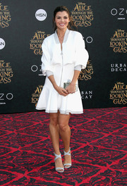 Ali Landry styled her dress with pale-blue crisscross-strap sandals.