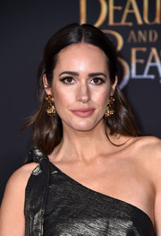 Louise Roe wore her hair down in center-parted waves when she attended the premiere of 'Beauty and the Beast.'
