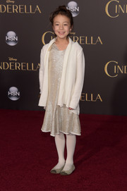 Aubrey Anderson-Emmons layered a white cardigan over a metallic dress for the Hollywood premiere of 'Cinderella.'