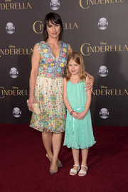 Constance Zimmer attended the 'Cinderella' Hollywood premiere wearing a sleeveless dress featuring a charming floral print.