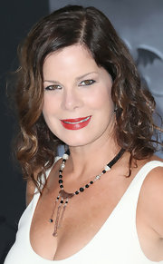 Marcia Gay Harden styled her deep-scoop dress with a multi-beaded necklace at the Disney movie premiere.