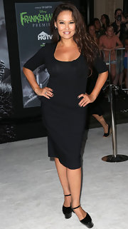 Tia Carrere showed off her voluptuous figure in a tight LBD at the premiere of 'Frankenweenie.'