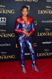 Tiffany Haddish finished off her colorful look with a pair of bright blue pumps.