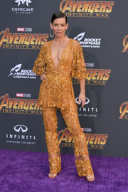 Evangeline Lilly flashed plenty of skin in a sheer, deep-V marigold peplum jumpsuit by Zuhair Murad Couture at the premiere of 'Avengers: Infinity War.'