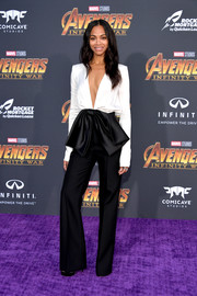 Zoe Saldana was all about cool glamour in a bow-adorned black-and-white jumpsuit by Givenchy at the premiere of 'Avengers: Infinity War.'