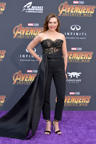 Elizabeth Olsen completed her look with a pair of black ankle-strap sandals by Jimmy Choo.