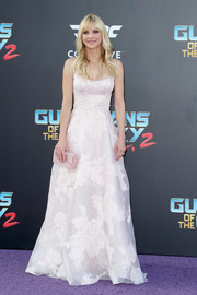 Anna Faris complemented her gown with a pearlescent pink box clutch by Edie Parker.