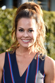 Brooke Burke-Charvet pulled her tresses up into a messy-glam ponytail for the premiere of 'Pete's Dragon.'