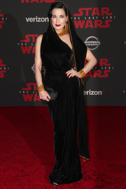 Dita Von Teese went for exotic glamour in a hooded black velvet gown by Jean Paul Gaultier Couture at the premiere of 'Star Wars: The Last Jedi.'