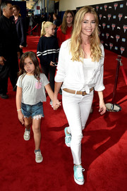 For a pop of color to her white look, Denise Richards accessorized with a pair of pastel-blue Converse sneakers.