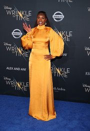 Issa Rae brought a bold pop of color to the premiere of 'A Wrinkle in Time' with this high-neck marigold satin gown by Pyer Moss.