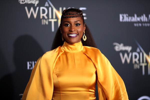 More Pics of Issa Rae Evening Dress (1 of 3) - Issa Rae Lookbook - StyleBistro [a wrinkle in time,face,yellow,head,beauty,fashion,hairstyle,forehead,talent show,outerwear,smile,arrivals,issa rae,california,los angeles,el capitan theatre,disney,premiere,premiere]