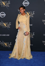 Meagan Good sealed off her look with a metallic oval clutch.