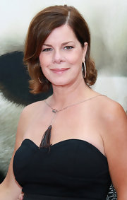 Marcia Gay Harden added a boho touch to her outfit by wearing a silver necklace with a leather tassel pendant at a movie premiere.