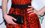 Krysten Ritter paired her leopard print red and black dress with a buckled black clutch, which worked well with he fun and flirty dress.