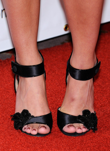 Laura crofted showed off her perfectly manicured feet while walking the red carpet in a pair of satin ankle strap heels. The flower embellishment were the ultimate accessory for her outfit.