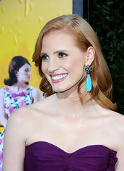 Jessica Chastain dazzled in a purple Oscar de la Renta look. She finished off her chic ensemble with a pair of vibrant blue earrings.