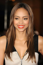 Actress Amber Stevens added a squeeze of mandarin lipstick to her natural look at the LA premiere of 'I Am Number Four'.
