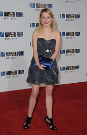 "Laura Slade Wiggins added a splash of color to her red carpet look at the premiere of ""I Am Number Four"" with a satin cobalt clutch."