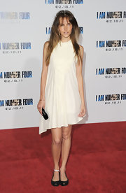Isabel Lucas donned black patent peep toe flats with her loose white shift.