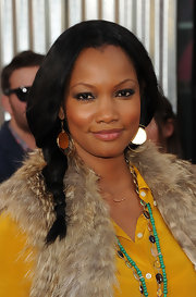 Garcelle Beauvais wore a lovely berry shade of lip color at the 'Real Steel' premiere. To get her look, try a sheer, moisturizing lipstick like Laura Mercier Lip Color-Creme in a shade like Audrey.