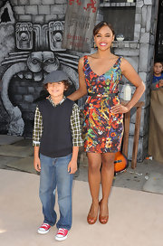 Sharon Leal belted a colorful abstract print dress for the LA premiere of 'Puss In Boots.'