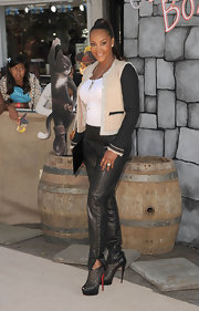 Vivica A. Fox gave her leather pants a ladylike vibe with a collarless two-toned jacket with metallic trim.