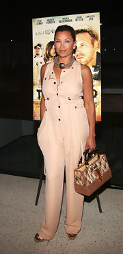 Vanessa paired her nude jumpsuit with a tweed tote bag.