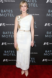 Vera Garmiga's white evening dress with gold embroidery on the shoulder was a classic Grecian-inspired look for the actress.