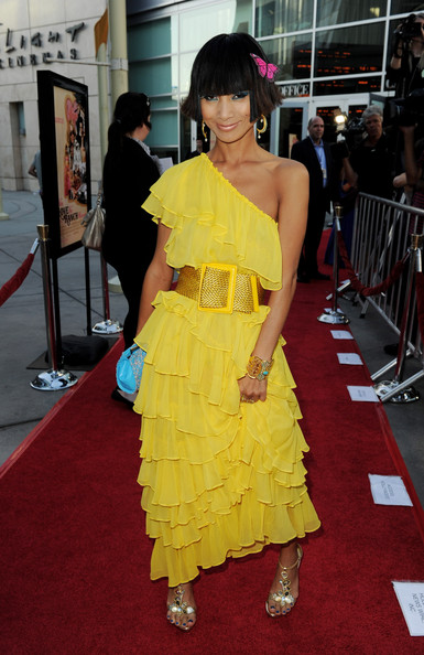 Bai Ling stood out in a ruffled yellow dress with a large, woven belt and a playful butterfly hair pin.