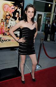 Kristen wore a crystal-embellished, strapless Fall 2010 LBD when she walked the red carpet in LA.