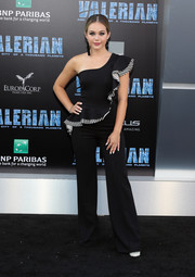 Brec Bassinger attended the premiere of 'Valerian and the City of a Thousand Planets' wearing a black one-shoulder jumpsuit with ruffle detailing.