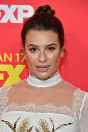 Lea Michele pulled her tresses up into a top knot for the premiere of 'The Assassination of Gianni Versace: American Crime Story.'