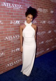 Zazie Beetz looked divine in a white halter column dress at the premiere of 'Atlanta Robbin' Season.'