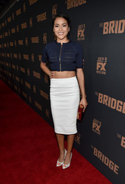 Emily Rios looked super slim in her white-hot pencil skirt.
