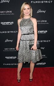 Radha Mitchell walked on the wild side with this white and black leopard print frock with bow waist accent.
