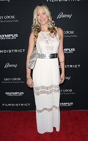 Kelli Giddish mixed hippie-chic with modern sleek with this white lace dress with a cool metallic belt.