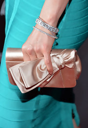 Ashley Judd added a nude satin clutch with a stylish bow detail to her red carpet look at the 'Olympus Has Fallen' premiere.