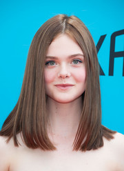 Debuting a darker hair color, Elle Fanning wore a sleek center-parted mid-length bob at the 'Boxtrolls' premiere.