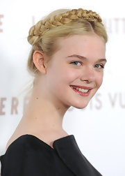 Elle swept her long blond locks up in a sleek braid. A modern center part completed her darling look.